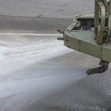 Nozzles spraying calcium chloride